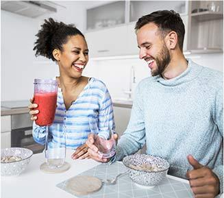Man and woman smiling in kitchen